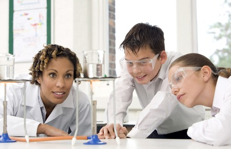 Woman with boy and girl carrying out science experiments Stock Photo