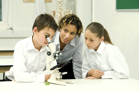 science lab: Woman with girl and boy in the science lab