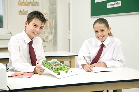 science lab: Girl and boy in the science lab Stock Photo