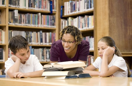 persuading: Woman persuading boy and girl to study