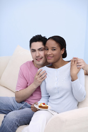 Man and woman posing on the couch photo