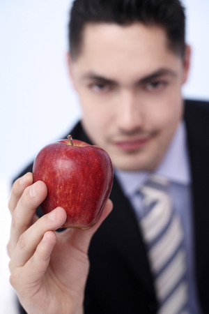 french ethnicity: Businessman holding a red apple