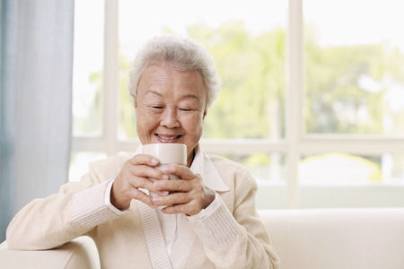 Senior woman enjoying a cup of coffee photo