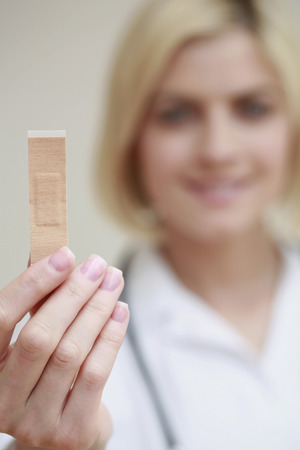 Woman holding a plaster