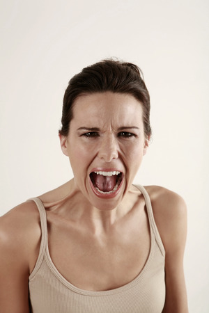 frowns: Woman screaming Stock Photo