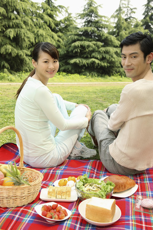 Man and woman having picnic in the park photo