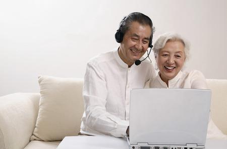 Senior couple sharing a laptop photo