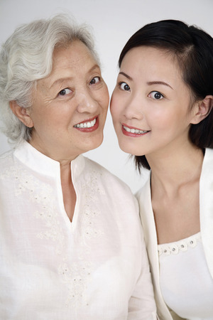 Woman posing with senior woman photo