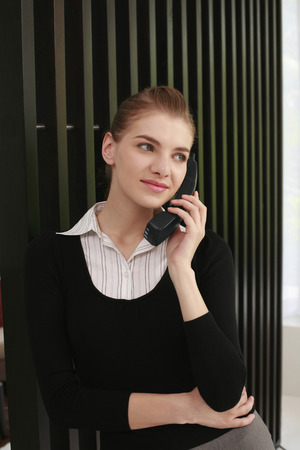 cordless phone: Woman in formal wear talking on cordless phone