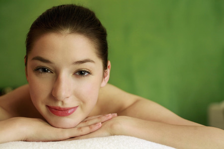 Woman lying forward on massage table