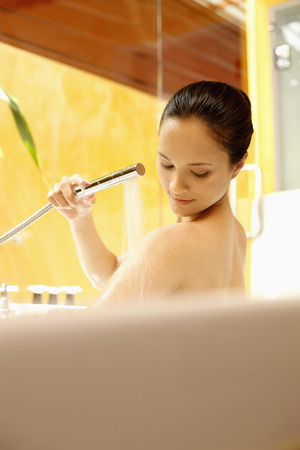 Woman washing in the bathtub photo
