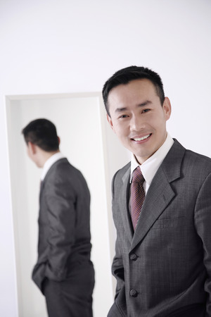 Businessman smiling at the camera photo
