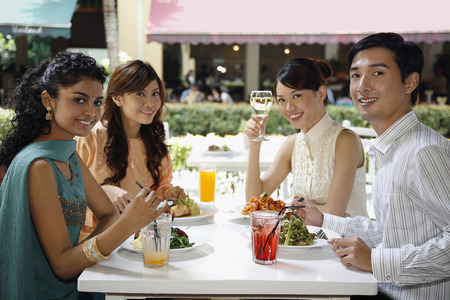 outdoor cafe: Man and women having lunch together