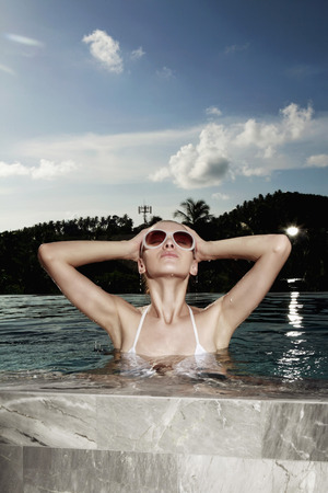 Woman relaxing in the pool photo