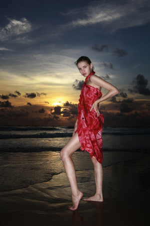 Woman posing on the beach photo