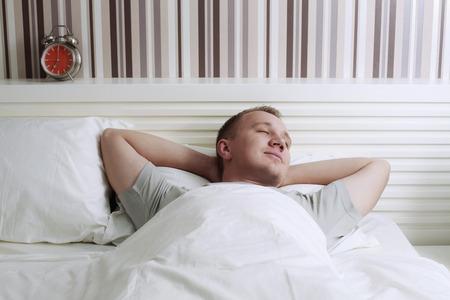 eyes closing: Man sleeping in bed
