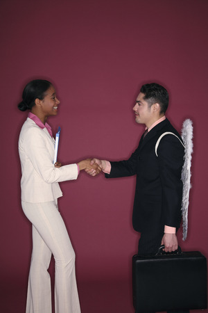 Businessman and businesswoman shaking hands photo