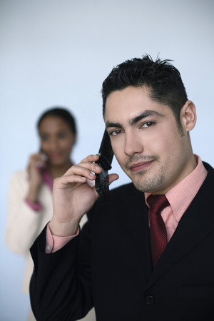 french ethnicity: Businessman and businesswoman talking on the phone Stock Photo