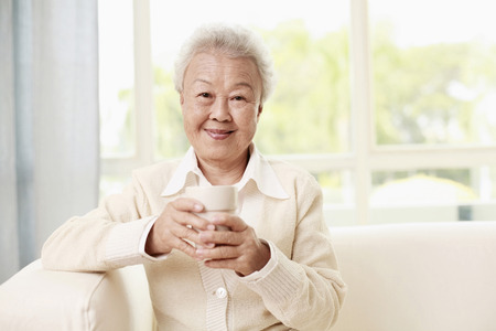 Senior woman with a cup of coffee photo