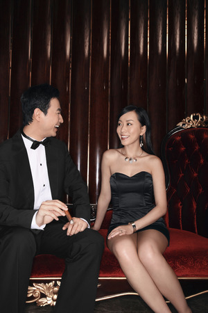 Man and woman talking at a night club photo