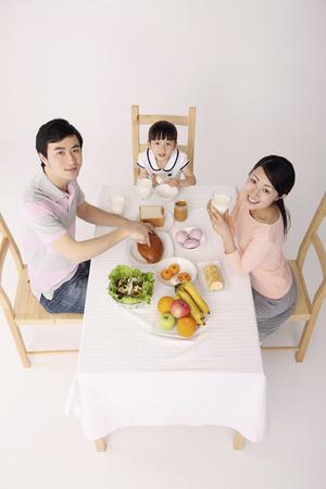 Family samen ontbijten Stockfoto