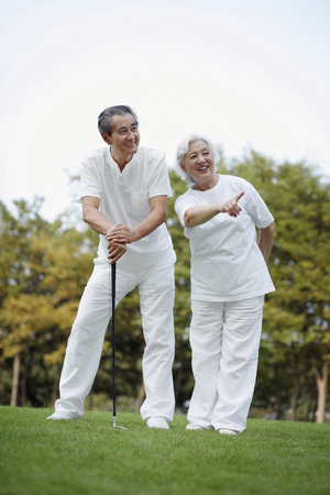Senior couple playing golf  photo