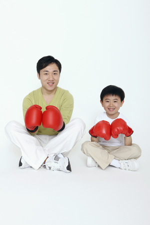 Man and boy in red boxing gloves photo