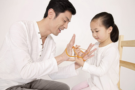 Man showing girl some rubber band tricks photo