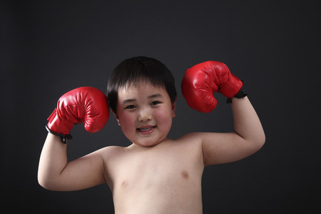 strong toughness: Boy with boxing gloves