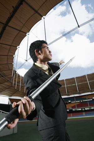 javelin: Businessman throwing a javelin Stock Photo