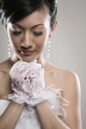 eyes closing: Woman closing her eyes and making a wish Stock Photo