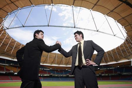 locking: Businessmen locking hands