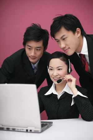 Business people working together on laptop photo