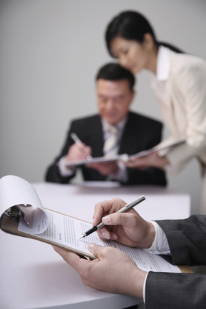 Businessman going through document before signing it photo