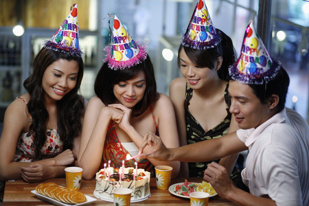 Woman celebrating birthday with her friends photo