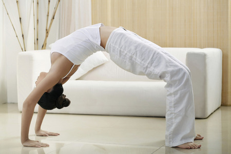 Woman doing backbend photo