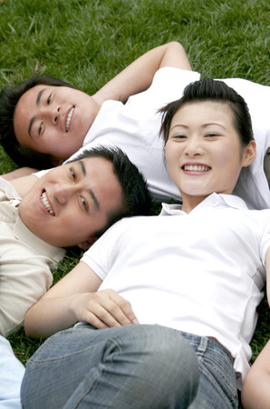 he   my sister: A lady lying on the grass together with her brothers