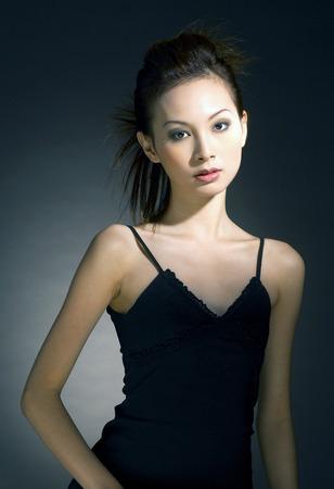 dinner wear: Studio shot of a lady in black dress
