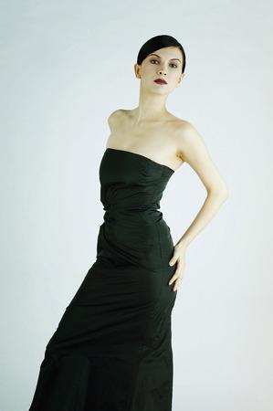 dinner wear: Studio shot of a lady in long black dress Stock Photo