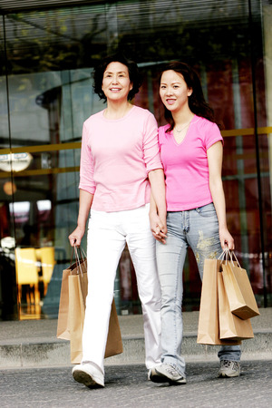 A mother and daughter with their shopping bags  photo