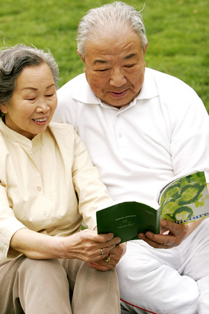 An old couple looking at a photo album  photo
