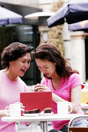 A woman opening the gift from her mother Stock Photo - 26382305