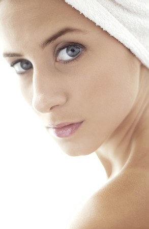 towel wrapped: Woman with towel wrapped hair looking at the camera