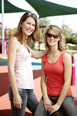 Two teenage Caucasian girls in a playground photo