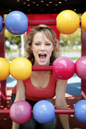 spaghetti strap: A teenage Caucasian girl having fun at the playground Stock Photo