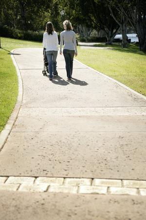 housemate: Two teenage Caucasian girls walking along the walkway