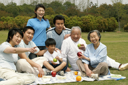 asian trees: A big family picnicking in the park