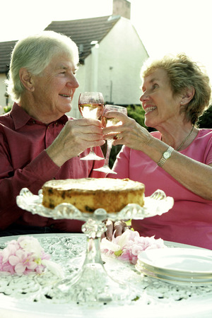 adoring: An old couple celebrating their anniversary in the garden