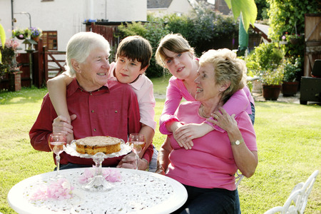 A girl and boy giving their grandparents a surprise visit photo