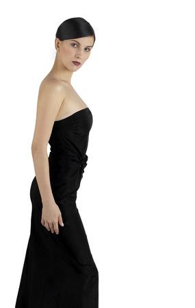 dinner wear: Side shot of a lady in black dinner dress